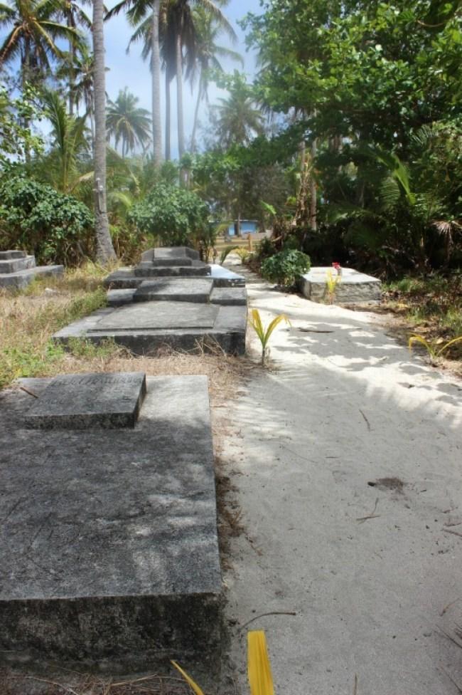 Hiking through a cemetery on Nacula Island in the Yasawa Islands of Fiji