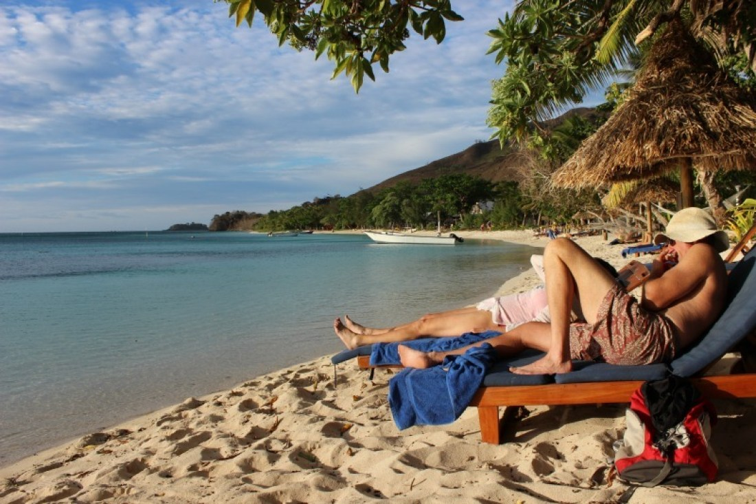 Relaxing at the beach on Nacula Island in the Yasawa Islands of Fiji