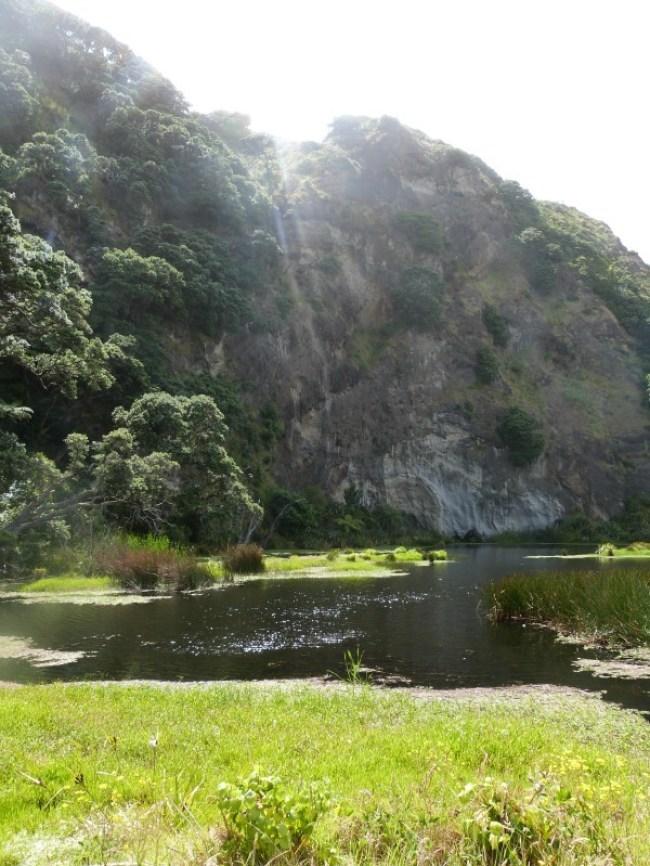 Hiking Karekare beach on the Hillary Trail in New Zealand
