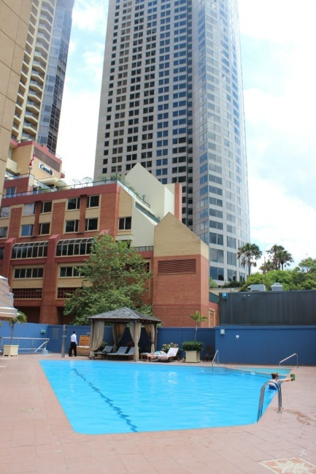 Relaxing at the pool at the Four Seasons in Sydney during our Staycation