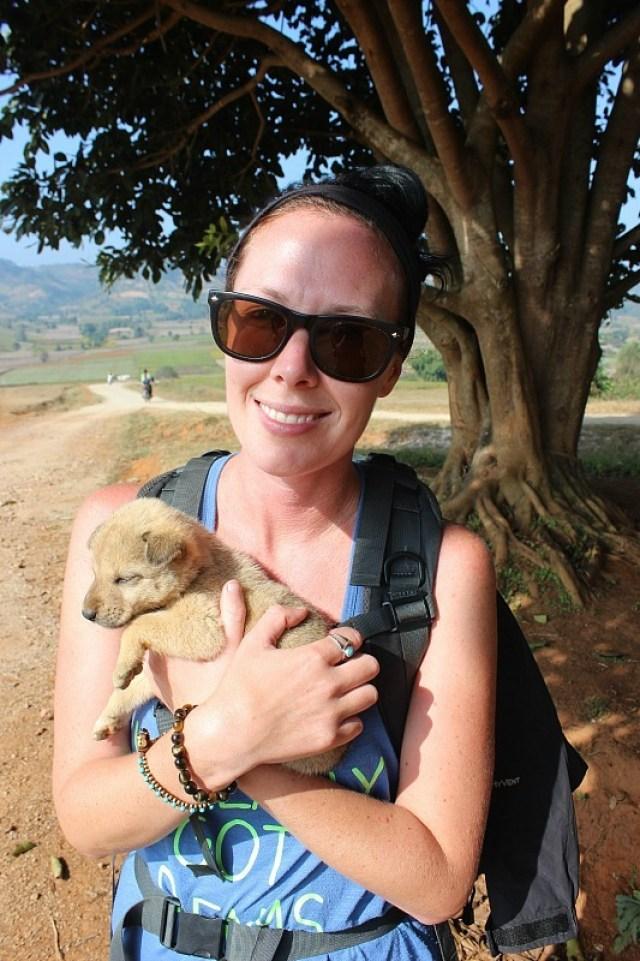 Cuddling puppies while trekking Kalaw to Inle Lake