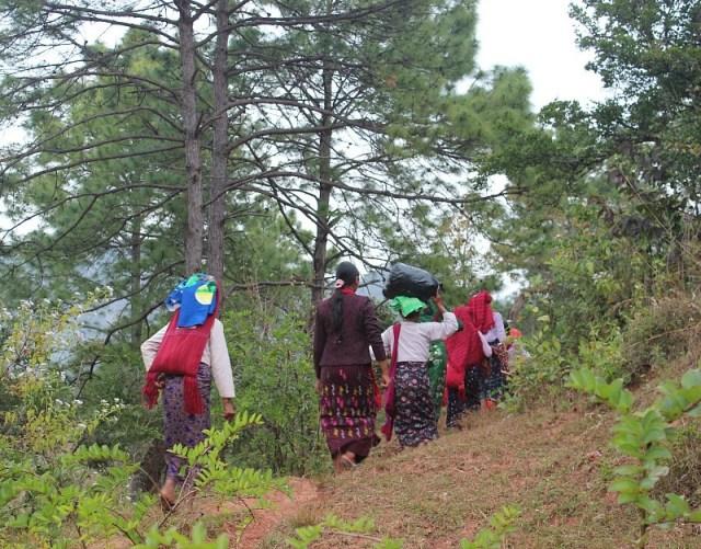 Local ladies hiking between villages during trekking Kalaw to Inle Lake