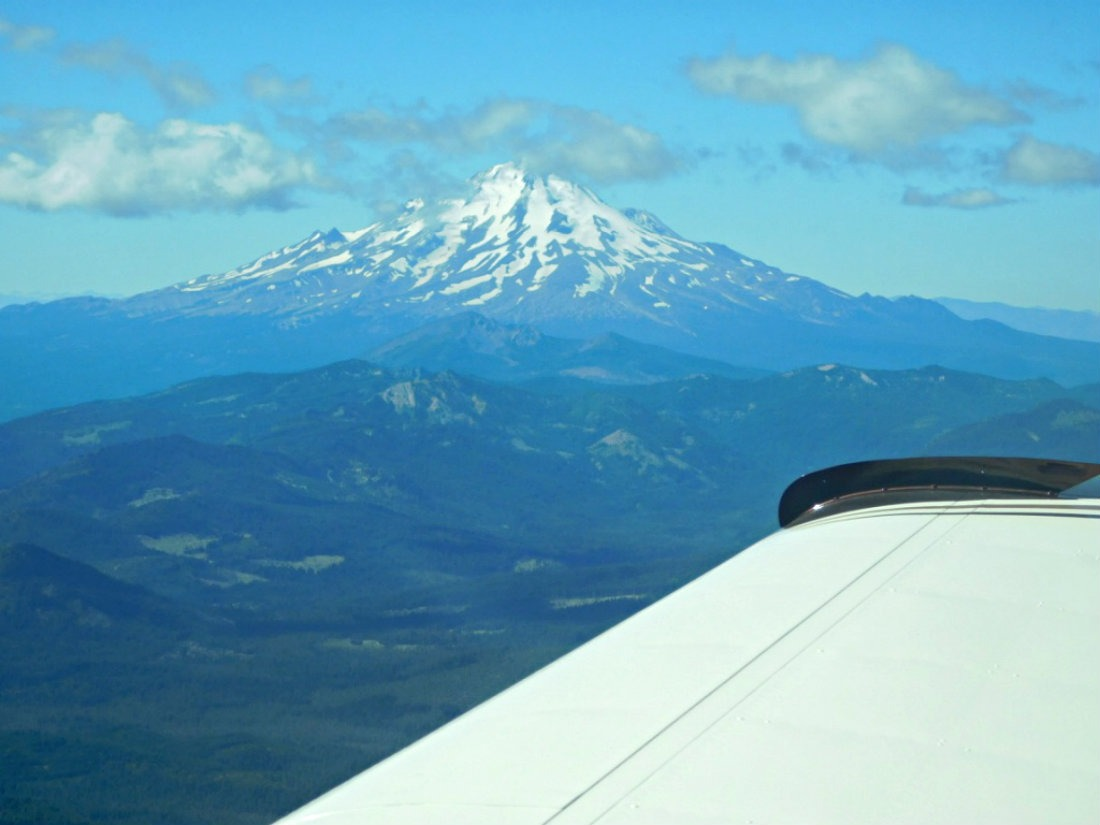 Flying in a tiny plane past Mount Shasta in Northern California during Month Twenty Eight of Digital Nomad Life