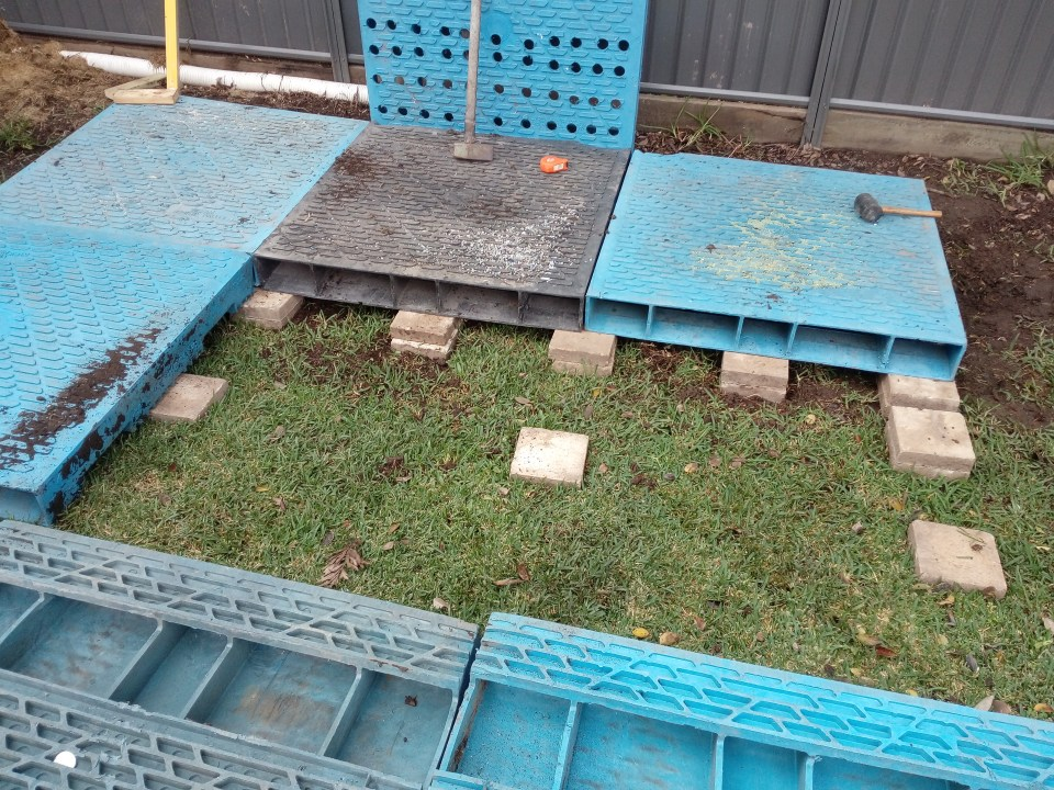 The Wedge Worm Farm - pavers under pallets