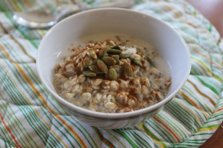 A breakfast favorite from Anna Jones - overnight Bircher Muesli with pepitas, chia seeds, rolled oats, almond milk, maple syrup, vanilla, and cinnamon on top.