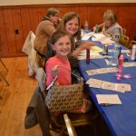 Family at designer purse bingo