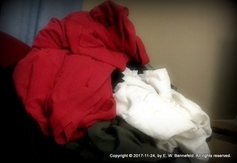 stack of clothing on a chair