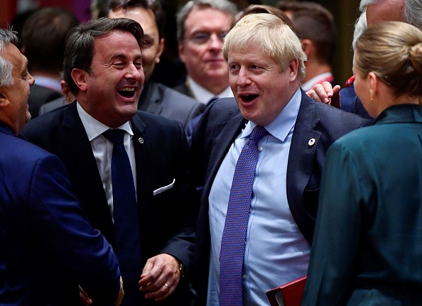 Luxembourg's Prime minister Xavier Bettel (C-L) and Britain's Prime Minister Boris Johnson (C-R) share a laugh during an European Union Summit at European Union Headquarters in Brussels on October 17, 2019. (Photo by John THYS / AFP) (Photo by JOHN THYS/AFP via Getty Images)