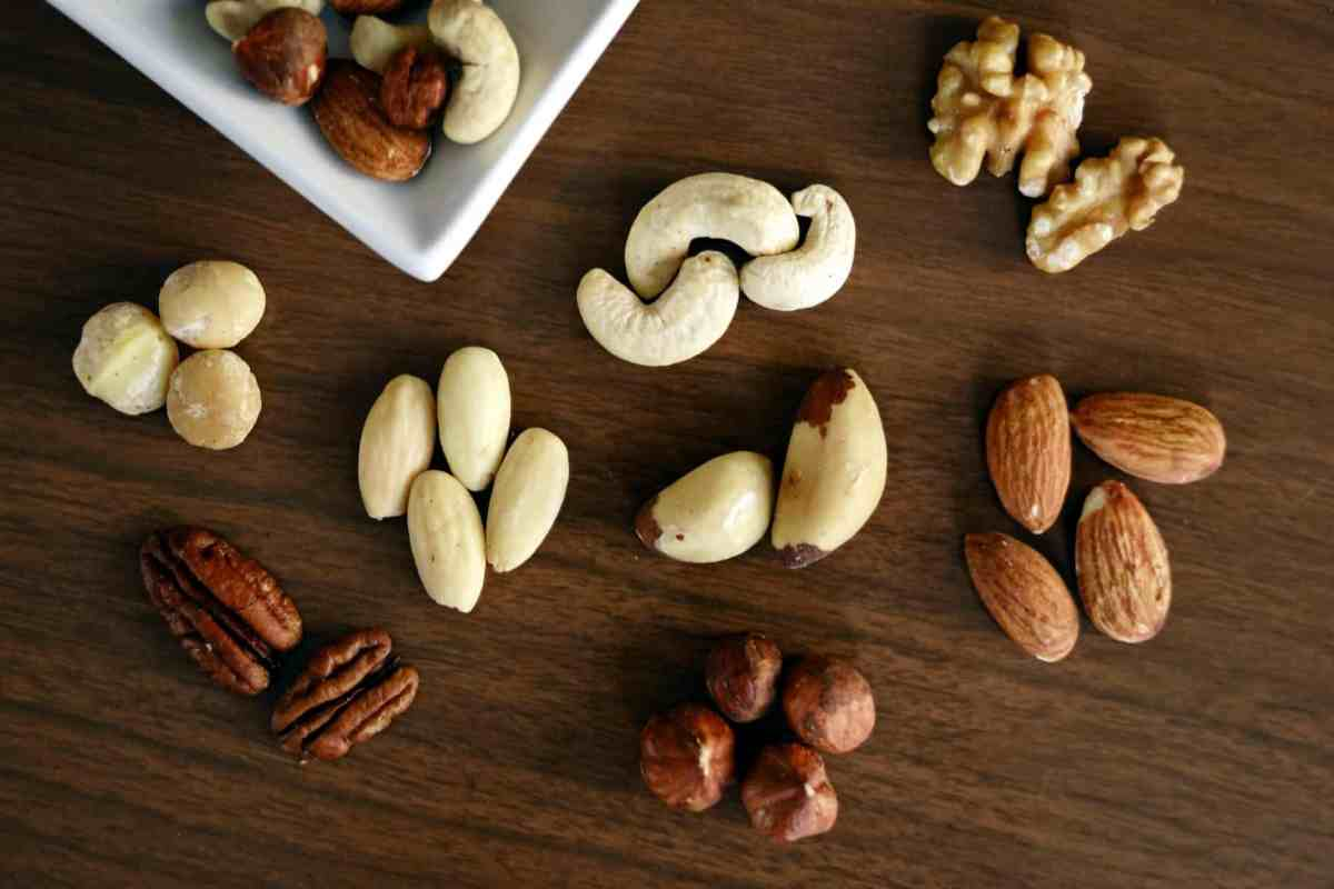 variety of brown nuts on brown wooden panel high angle photo