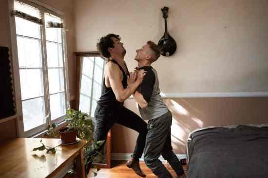 men pushing each other