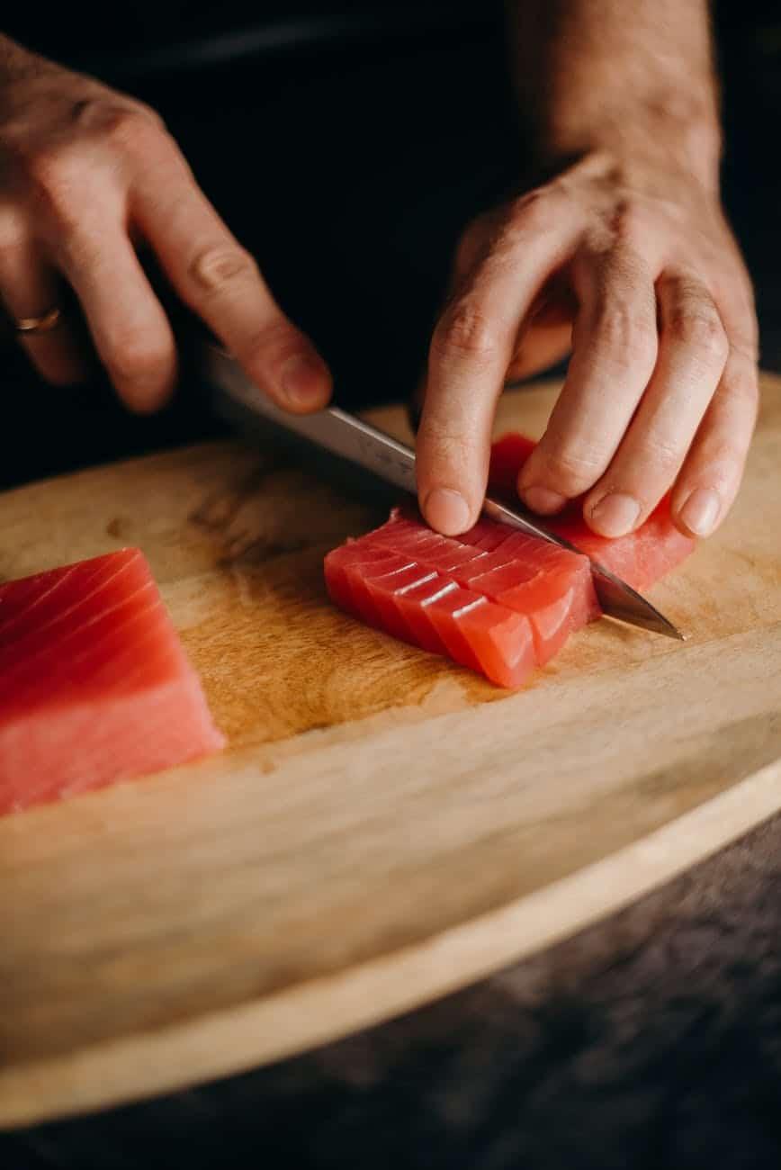 chef slicing fresh tuna meat