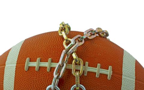 Football in chains.  © Fabio Alcini | Dreamstime.com