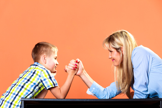 Mother and son arm wrestling  © Voyagerix | dollarphotoclub.com