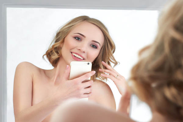 Wife taking nude selfie in mirror.