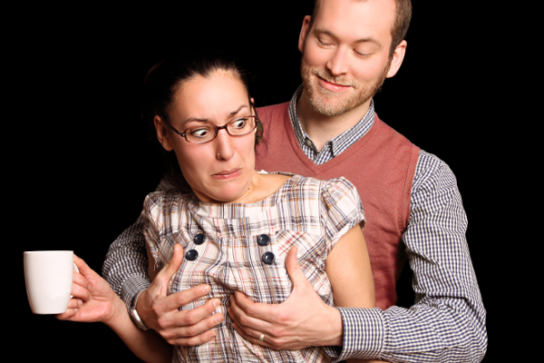Husband grabbing his wife's breasts without warning
