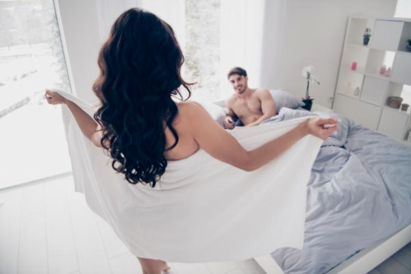 Woman in towel flashing her husband.