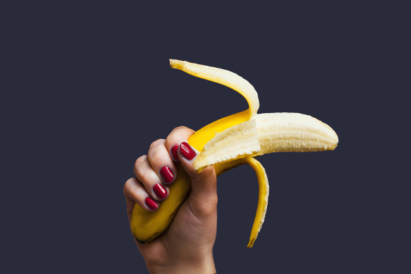 Female hand holding banana