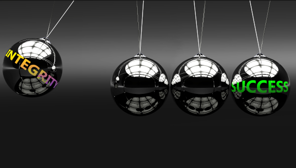 Meaning, ideas and relation of two concepts: integrity and success, pictured as Newton cradle with metal balls giving energy and momentum to each other.