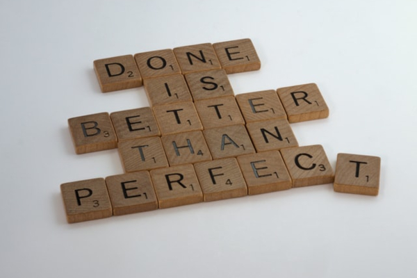"Scrabble tiles reading ""Done is better than perfect"""