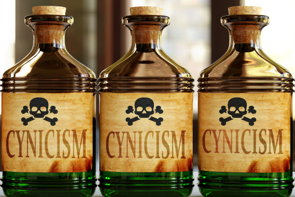 Cynicism can be like a deadly poison - pictured as word Cynicism on toxic bottles