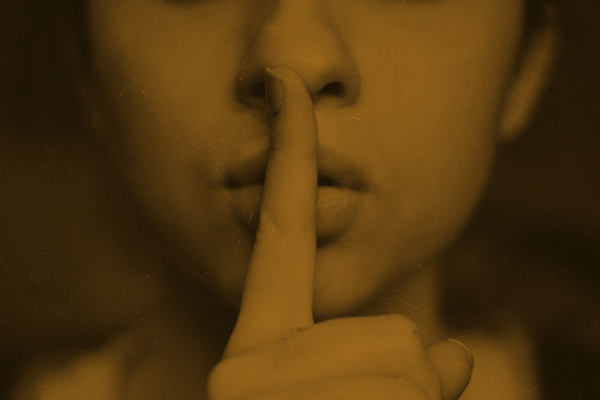 Woman with finger to lips