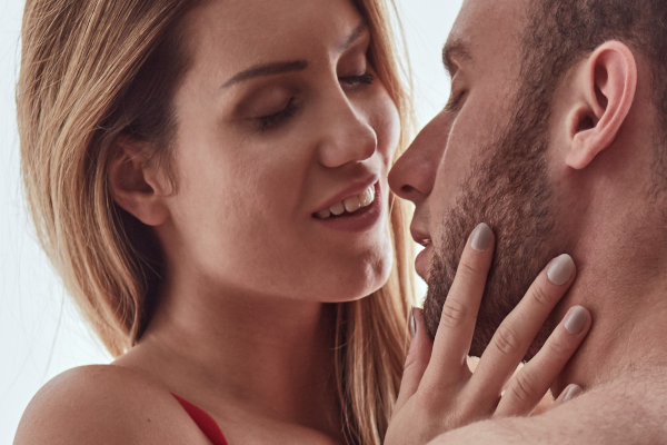 Woman enjoying foreplay with her husband