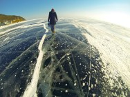 Anna exploring the amazing ice of frozen Lake Baikal. 6 feet thick at some points, and extremely clear when frozen under the right conditions.