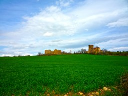 Ruins of an old palace in the middle of some beautiful farm fields in the province of Navarra, Spain.