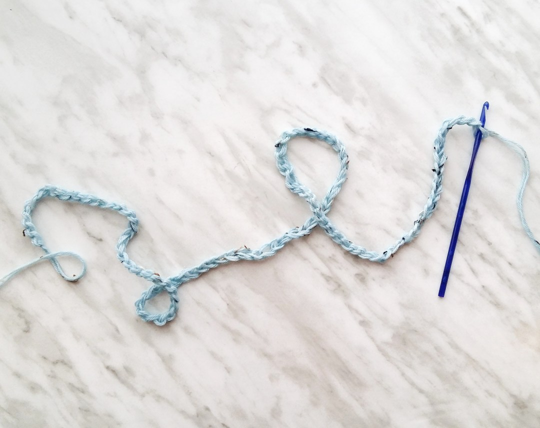 Use 2 strands of yarn together, chain 103