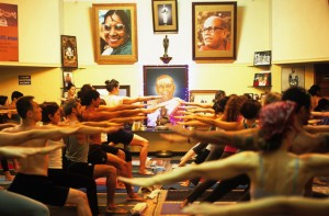 Students practice Ashtanga Yoga in Mysore, India.