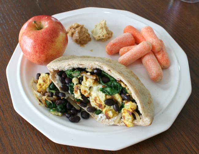black bean, egg, onion, tomato pita + apple, carrots, hummus, and peanut butter