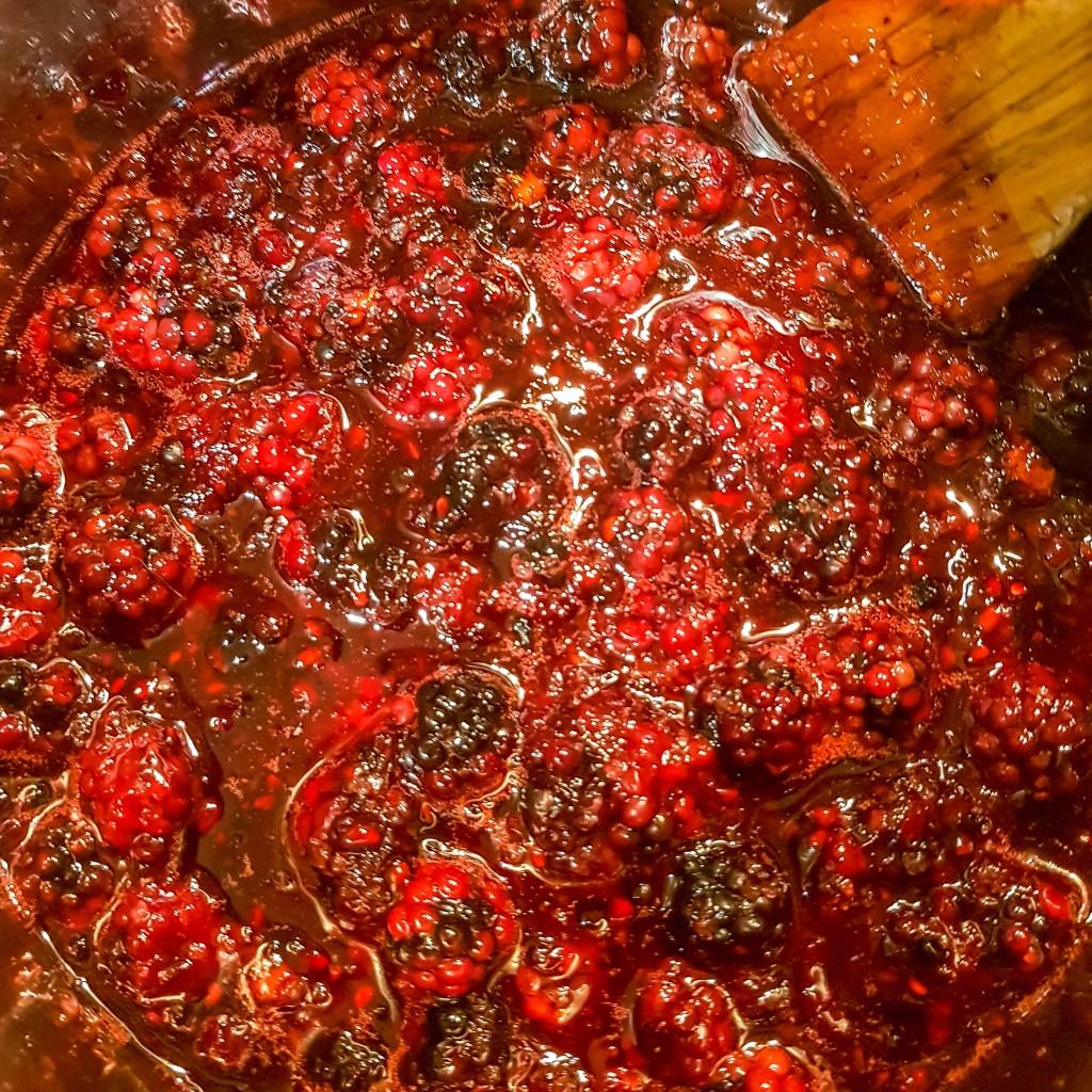 blackberry jam bubbling in pan
