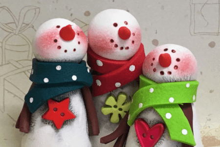 3 snowman crafted out of polymer clay