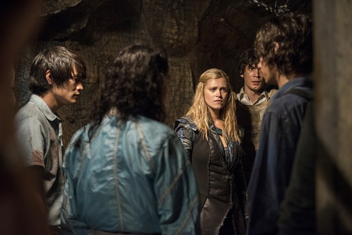 """The 100 -- """"Blood Must Have Blood, Part Two"""" -- Image HU216B_0327 -- Pictured (L-R): Chris Larkin as Monty, Eve Harlow as Maya, Eliza Taylor as Clarke, Bob Morley as Bellamy, and Devon Bostick as Jasper -- Credit: Cate Cameron/The CW -- © 2015 The CW Network, LLC. All Rights Reserved"""