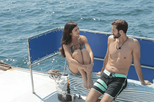 Caila and Brett getting cozy on a boat Credit: ABC