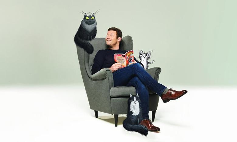 Museum of London celebrate Dermot O'Leary's new book with a pawsome online event. The photo features Dermot sitting in an armchair with illustrated cats all around him.