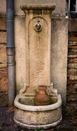 An old spigot provides water for gardening.