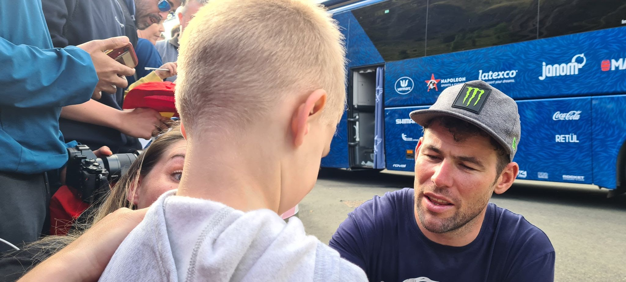 Mark Cavendish signs autograph for young boy