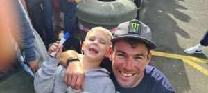 Mark Cavendish hugs young boy