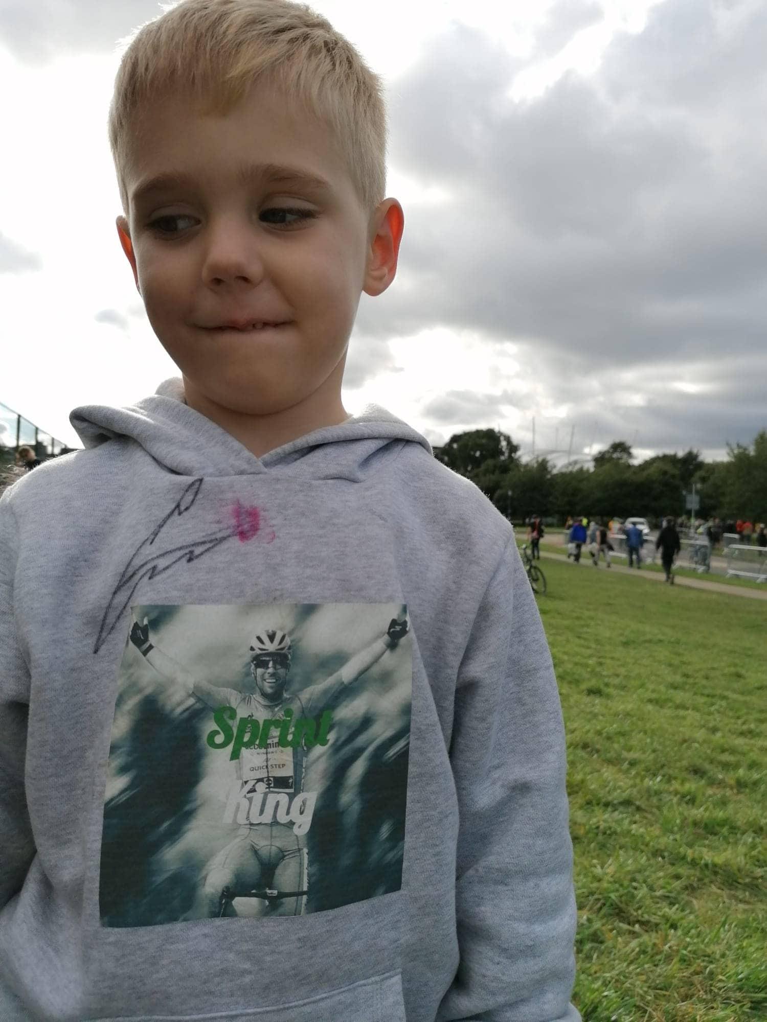 Young boy with bike racer on his hoodie sweatshirt