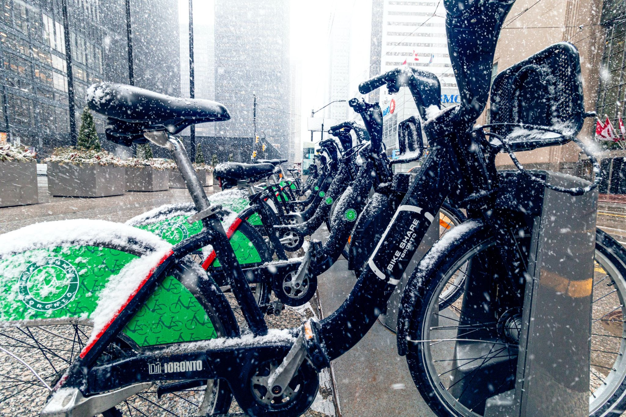 bikes in rack while snow is falling