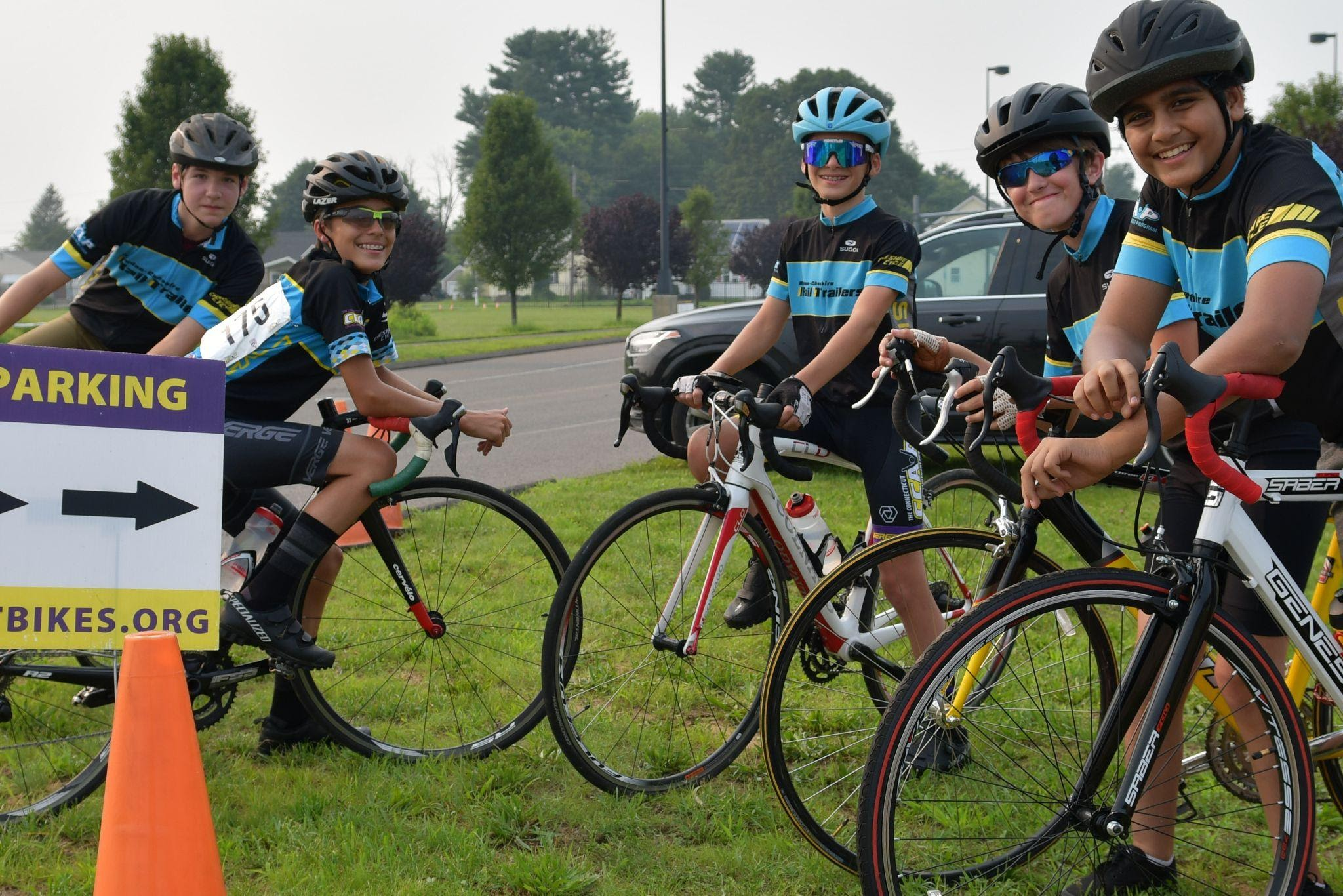 junior bike racers smiling after a race