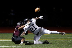 Torrington's Dominick Phengkaen, left, is called for pass interference while defending Ansonia's Angel Falero  during their NVL matchup on Friday night.     Christopher Massa Republican-American