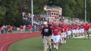 Cheshire Coach Don Drust leads his team off the field