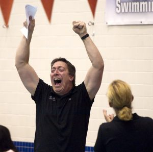 Cheshire head coach Dan Mascolo celebrates during the SCC swim finals at Southern Connecticut State University in New Haven. (Jim Shannon/RA)