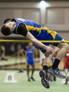 "Seymour's Lucas Bowen clears the 5'6"" high jump bar at Hillhouse High School Monday. The height is his personal best at the event. Erin Covey Republican-American"