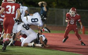 Ansonia's Justin Lopez  (8) dives in for a touchdown during their season opening game against Wolcott Friday at Wolcott High School.  Jim Shannon Republican American