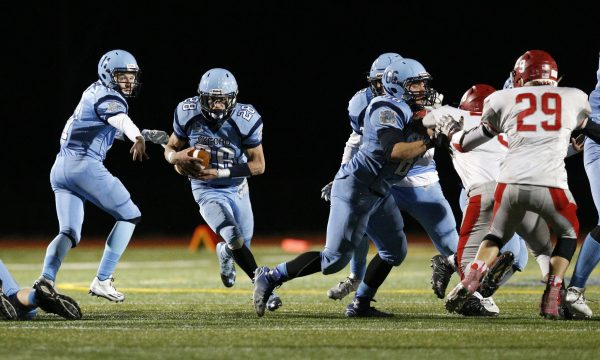 Oxford's Tyler Jacob hands the ball off to Griffin Downs, who runs the ball in for a touchdown. (Christopher Massa/RA)