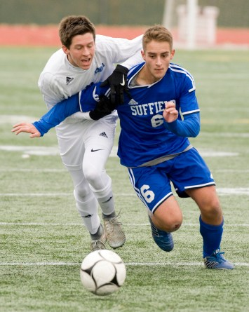 Lewis Mills' Carter Viets (3) Suffield's David Swan(6) get tangled up while fighting for the ball during their Class M state final game Saturday at Willow Brook Park in New Britain. Jim Shannon Republican-American