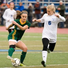 Holy Cross' Madison Bushka (13) makes a move to get around Old Lyme's Ellery Zrenda (6) during their Class S state final game Saturday at Middletown High School. Jim Shannon Republican-American